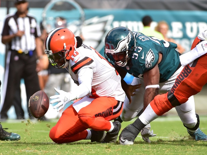 Cleveland Browns quarterback Robert Griffin III (10) recovers his fumble after being stripped by Philadelphia Eagles defensive end Brandon Graham (55) during the fourth quarter at Lincoln Financial Field. The Eagles defeated the Browns, 29-10.