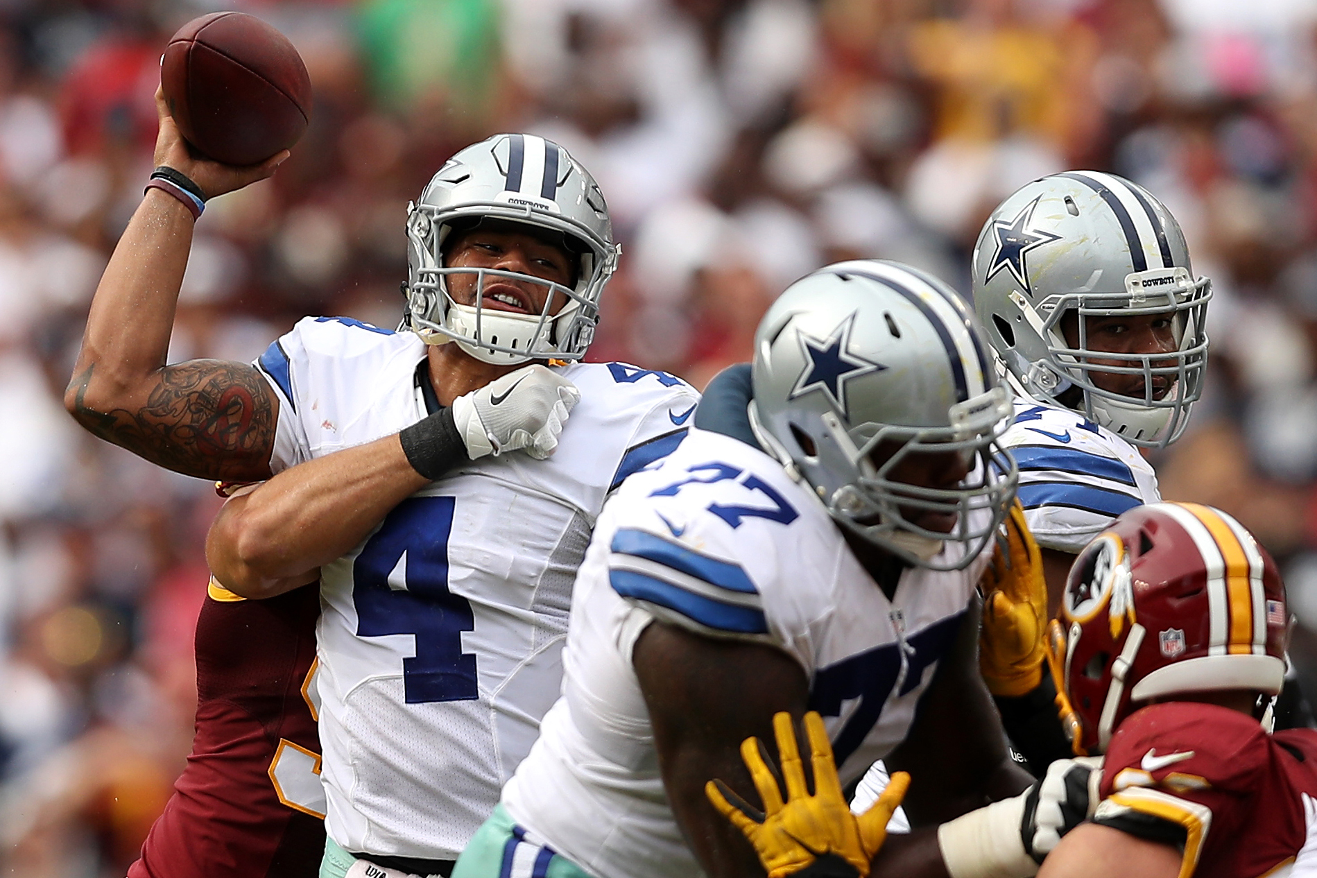 Quarterback Dak Prescott #4 of the Dallas Cowboys passes against the Washington Redskins in the fourth quarter at FedExField on September 18, 2016 in Landover, Maryland.
