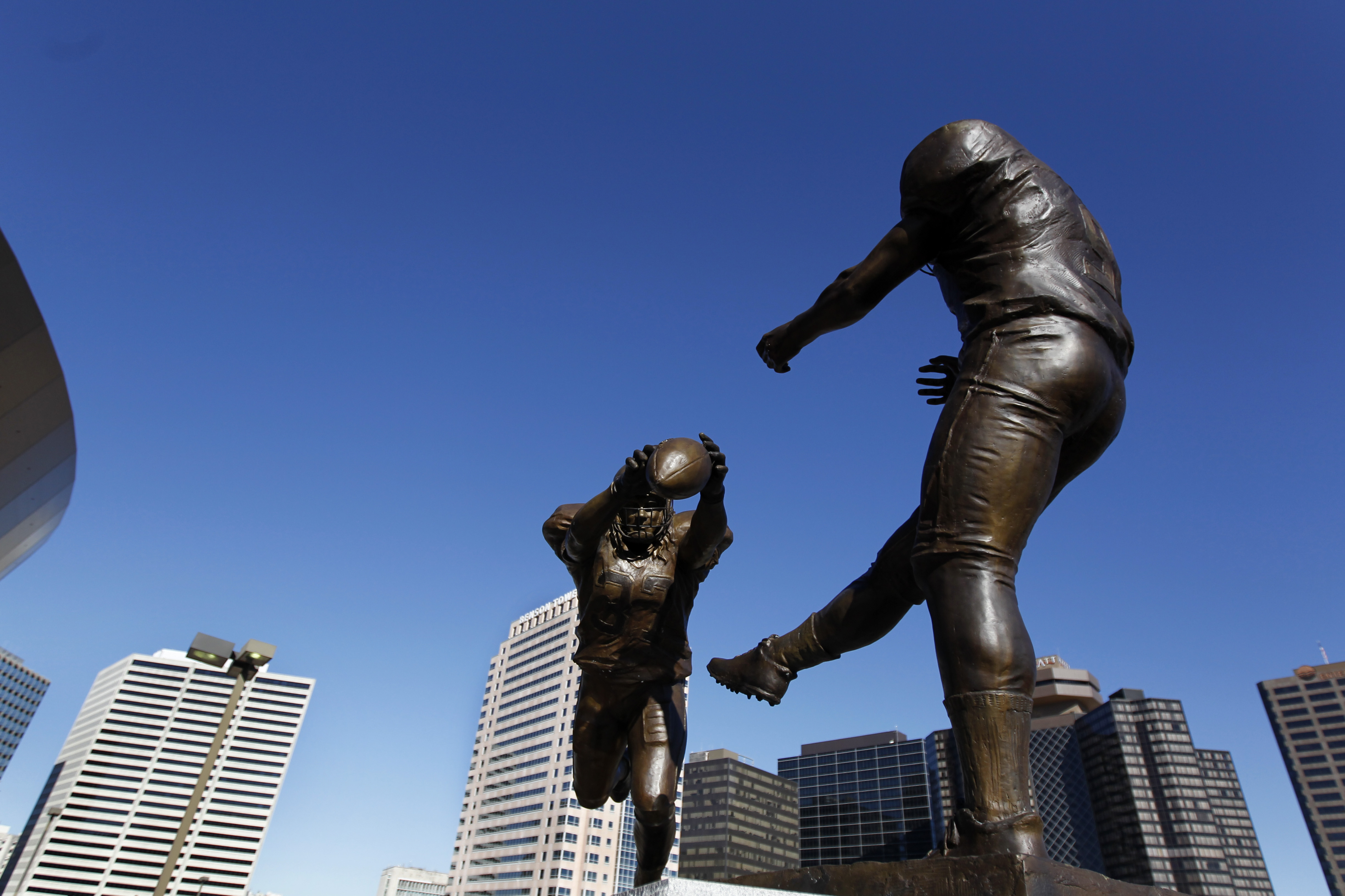 The bronze statue titled 'Rebirth,' which shows former New Orleans Saint Steve Gleason blocking a punt against the Atlanta Falcons during the first Monday Night Football game after the Superdome re-opened after Hurricane Katrina, is seen, outside the Mercedes-Benz Superdomein New Orleans, Thursday, Nov. 8, 2012.