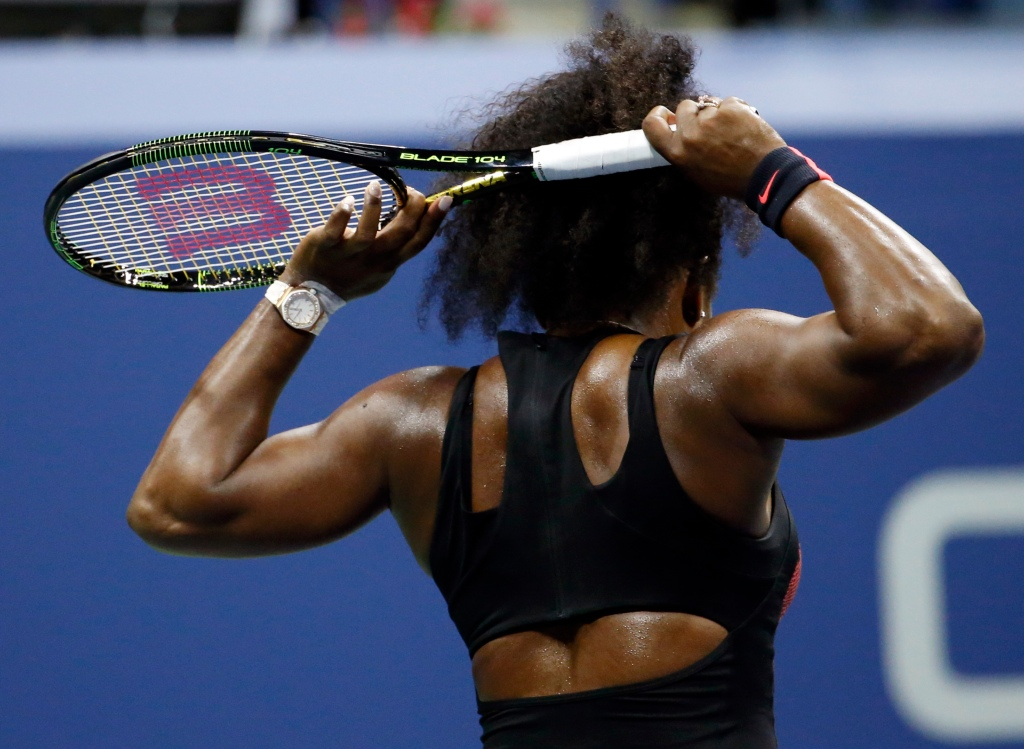 Serena Williams reacts after losing a point to Venus Williams during a quarterfinal match at the U.S. Open tennis tournament, Tuesday, Sept. 8, 2015, in New York.