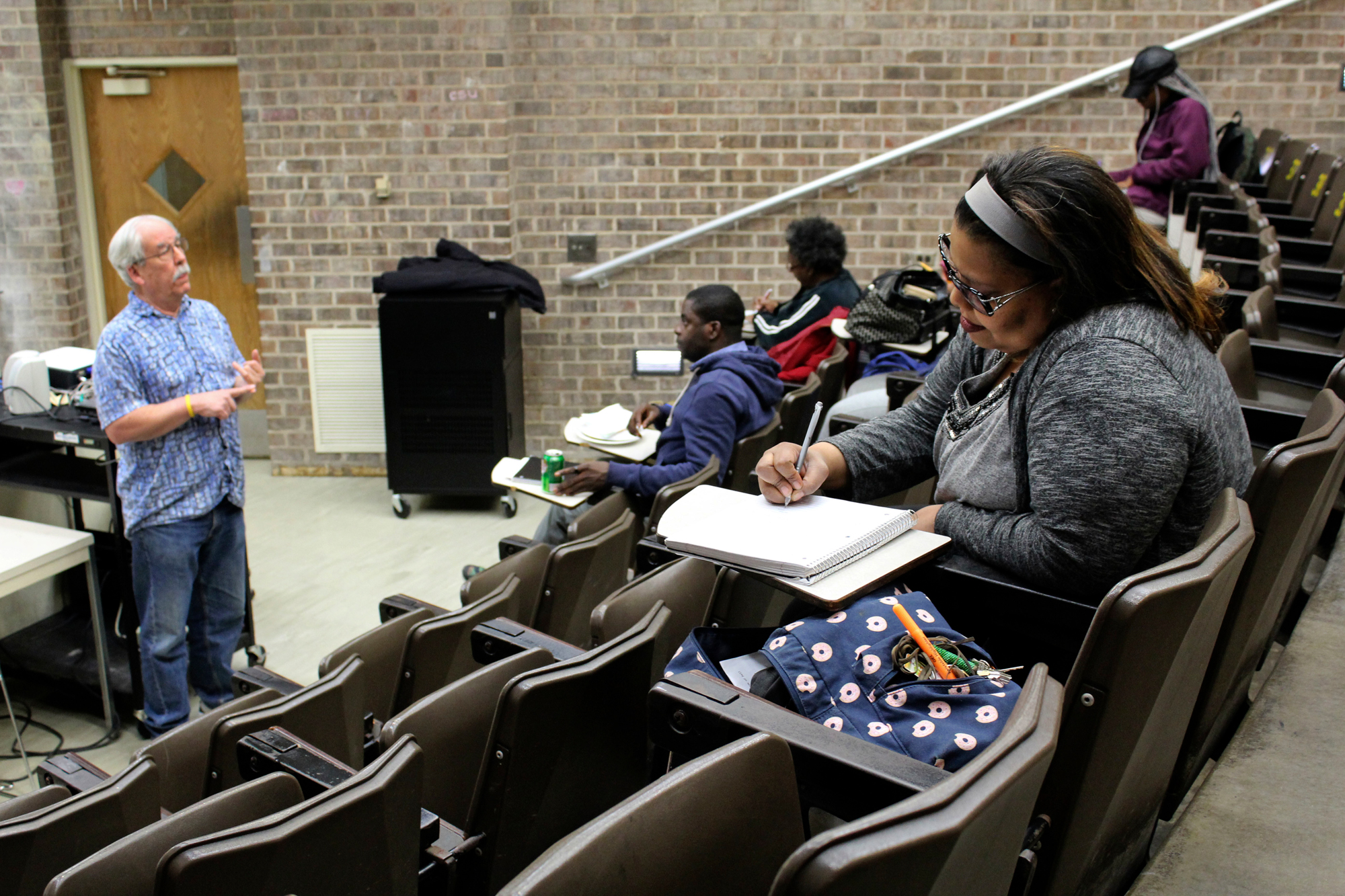 In this April 12, 2016 photo, Robert Bionaz, an associate professor of history at Chicago State University, lectures during a class at the university in Chicago. The school has a troubled history and has been hard hit by the state budget crisis, but students and experts say it remains a last shot for many to get a degree.