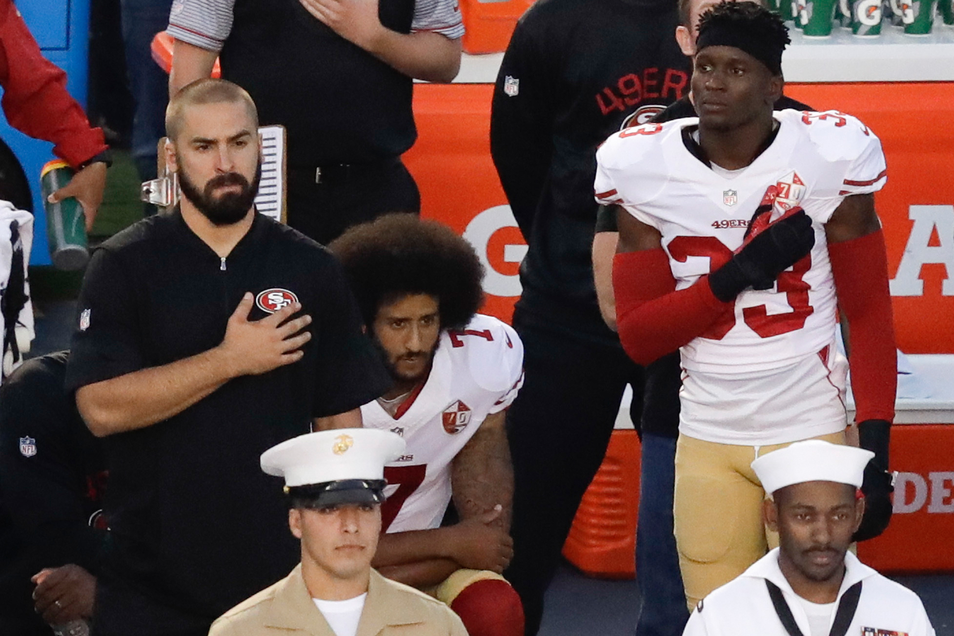 San Francisco 49ers quarterback Colin Kaepernick (C) kneels during the  national anthem before the team s NFL preseason football game against the  San Diego ... d0896748c
