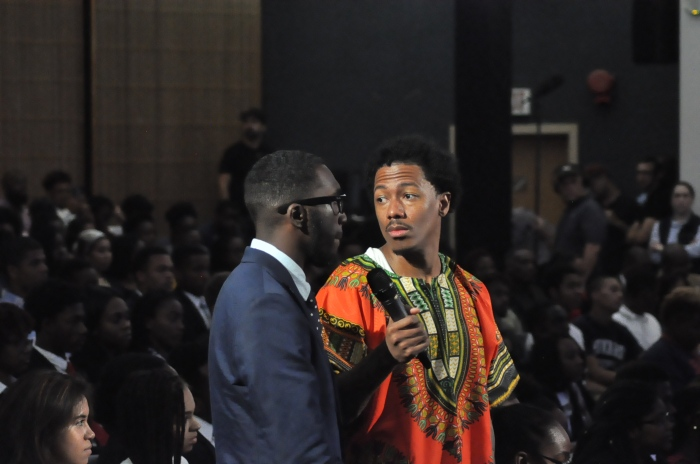 Nick Cannon taking questions from a crowd of students at Howard University.