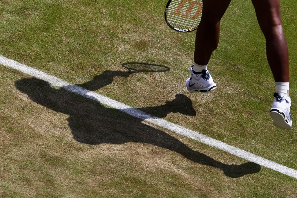 Serena Williams of the United States in action during her second round match against Simona Halep of Romania on Day Four of the Wimbledon Lawn Tennis Championships at the All England Lawn Tennis and Croquet Club on June 23, 2011 in London, England.