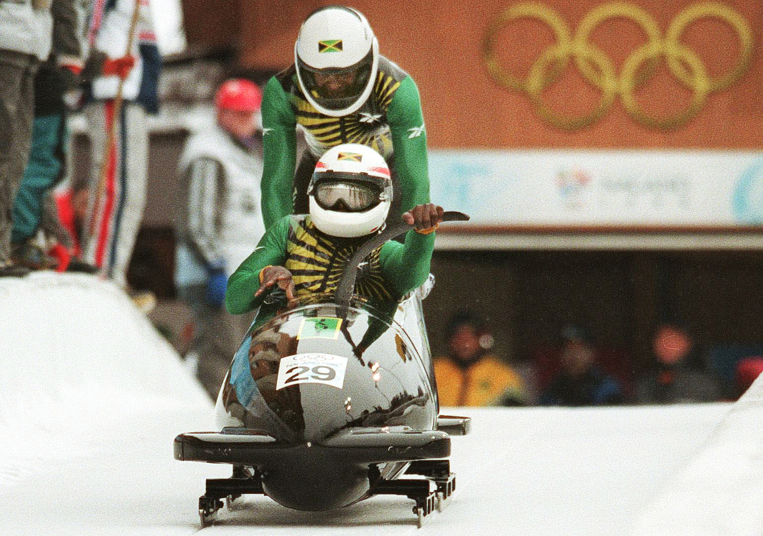 Devon Harris (front) and Michael Morgan (rear), of Jamaica, start their run on the first day of the two-man bobsleigh event at the Spiral near Nagano 14 February. The Jamaicans finished the d in thirtieth position.