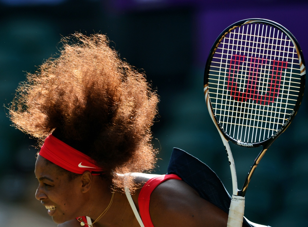 US Serena Williams servesagainst Belarus' Victoria Azarenka during their women's singles semifinal round match at the 2012 London Olympic Games at the All England Tennis Club in Wimbledon, southwest London, on August 3, 2012.