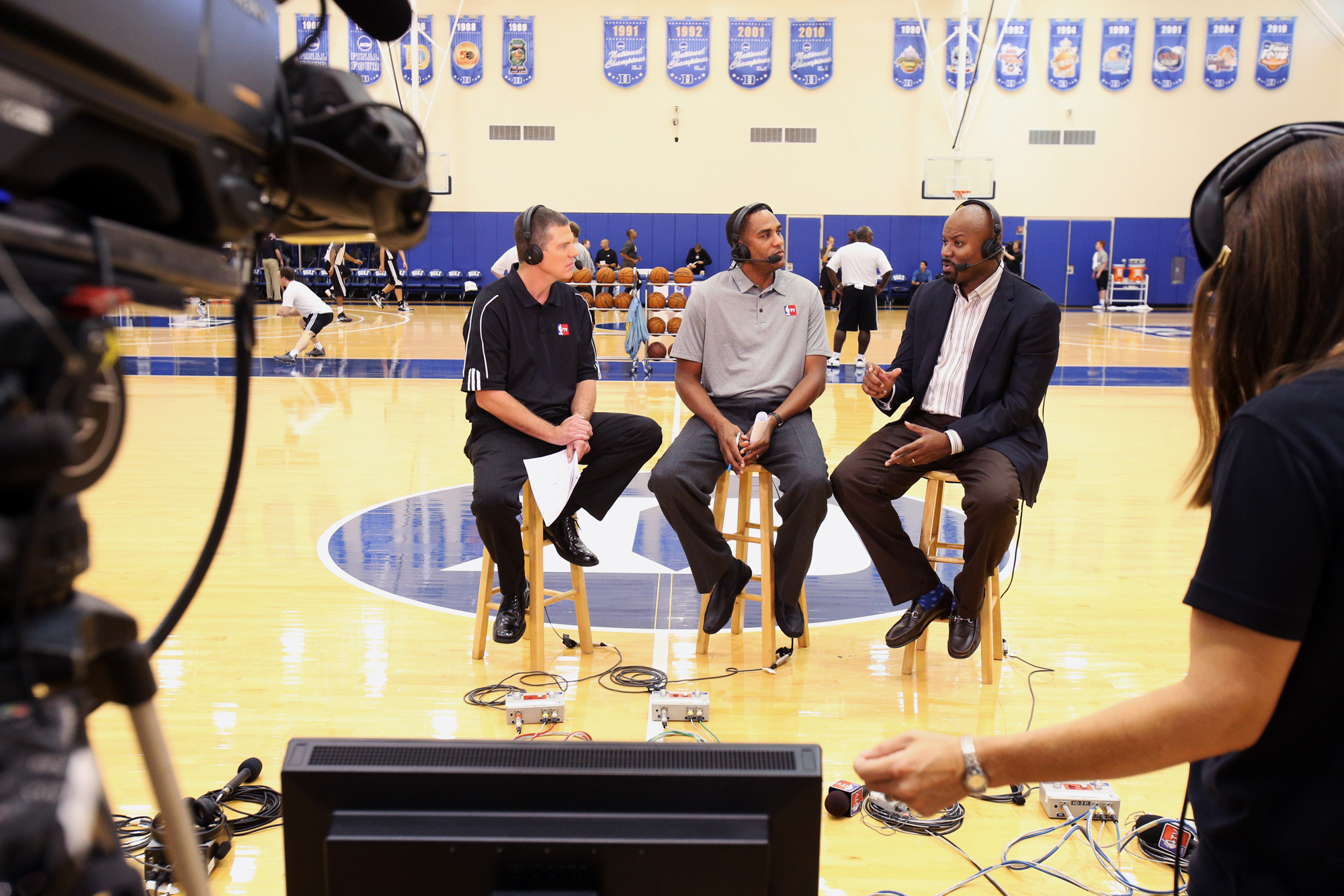 Rick Kamla and Steve Smith of NBA TV ask questions to Nets General Manager, Billy King on set during NBA-TV's Real Training Camp in Durham, North Carolina.