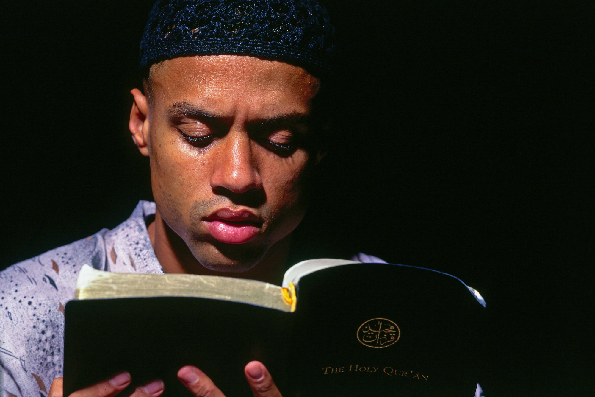 Mahmoud Abdul-Rauf #3 of the Denver Nuggets reads the Quran circa 1995 in Denver, Colorado.
