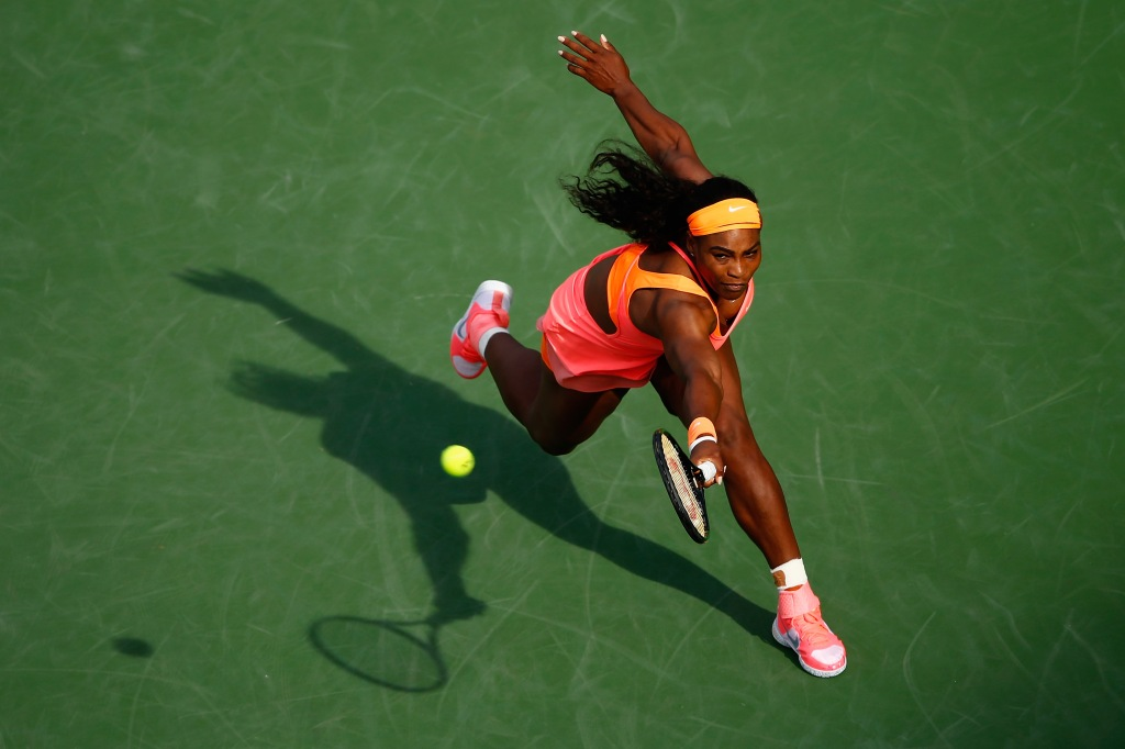 Serena Williams of USA in action against Zarina Diyas of Kazakhstan during day seven of the BNP Paribas Open tennis at the Indian Wells Tennis Garden on March 15, 2015 in Indian Wells, California.