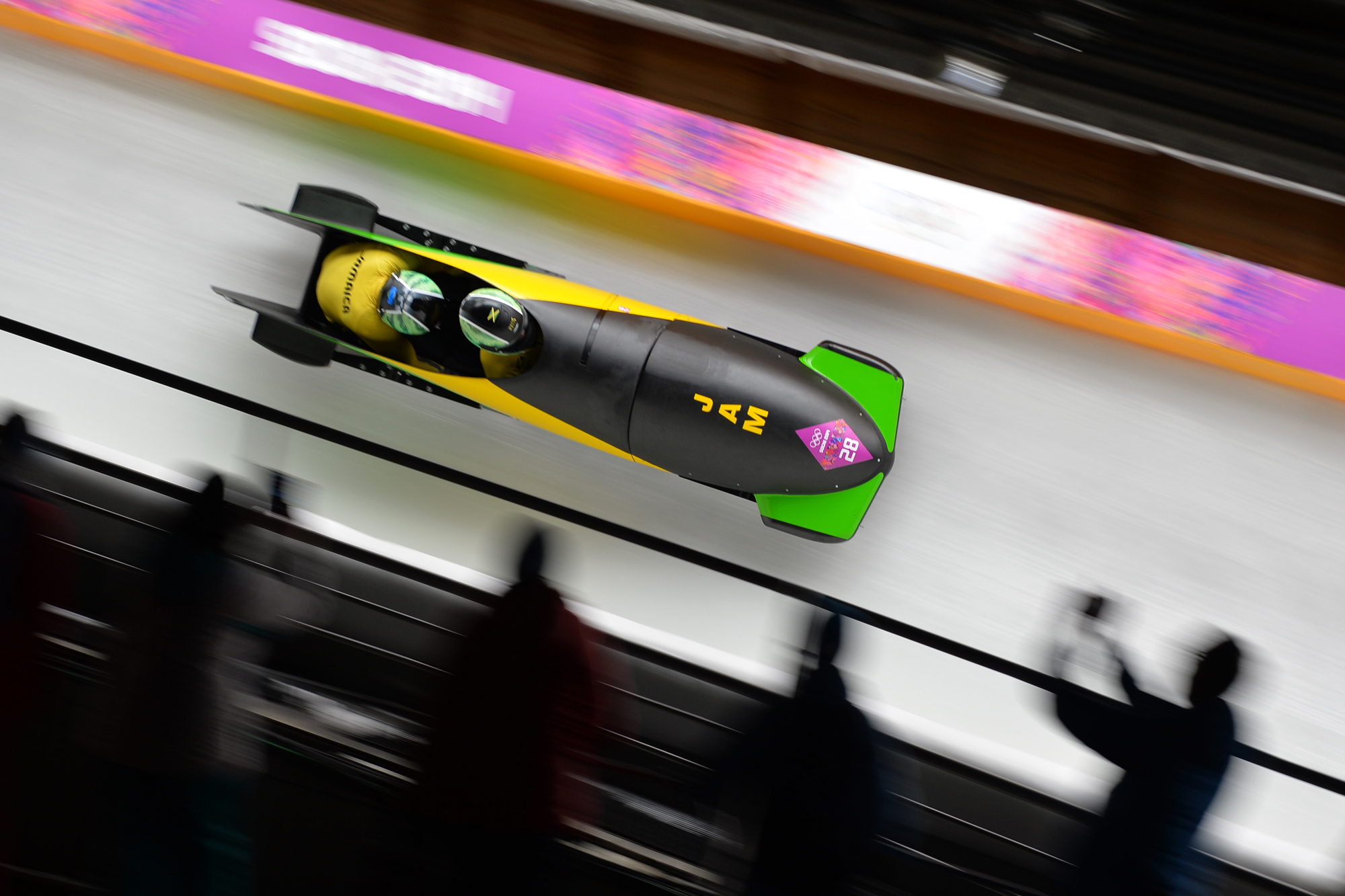 Jamaica-1 two-man bobsleigh steered by Winston Watts races in the Bobsleigh Two-man, Heat 1 at the Sanki Sliding Center in Rosa Khutor during the Sochi Winter Olympics on February 16, 2014.