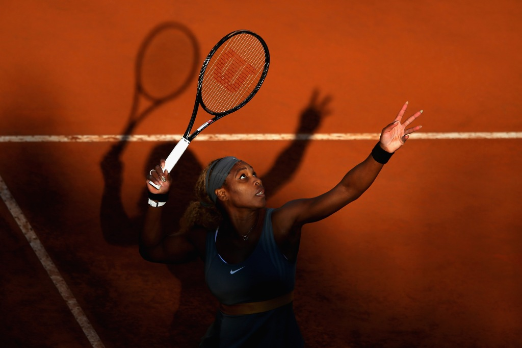 Serena Williams of USA serves to Ana Ivanovic of Serbia during day seven of the Internazionali BNL d'Italia tennis 2014 on May 17, 2014 in Rome, Italy.