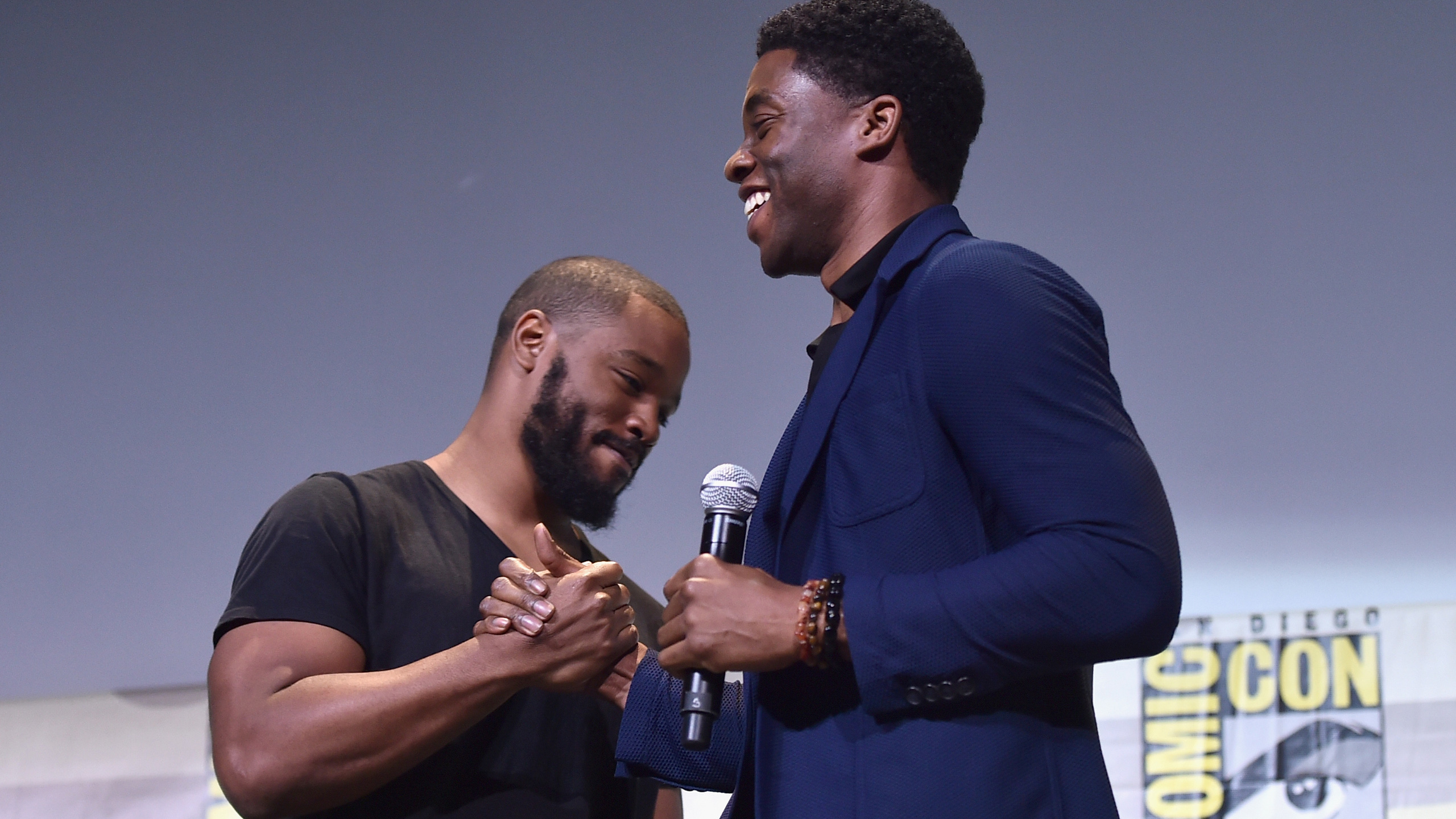 "SAN DIEGO, CA - JULY 23: Director Ryan Coogler (L) and actor Chadwick Boseman from Marvel Studios ""Black Panther attend the San Diego Comic-Con International 2016 Marvel Panel in Hall H on July 23, 2016 in San Diego, California. ©Marvel Studios 2016"