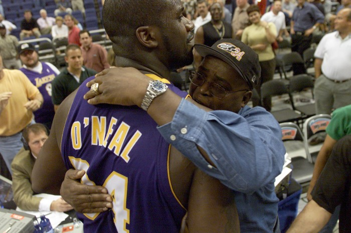 Shaquille O''Neal #34 of the Los Angeles Lakers gets a hug from his dad after game two of the Western Conference Finals between the Los Angeles Lakers and the San Antonio Spurs at the Alamo Dome in San Antonio, Texas.