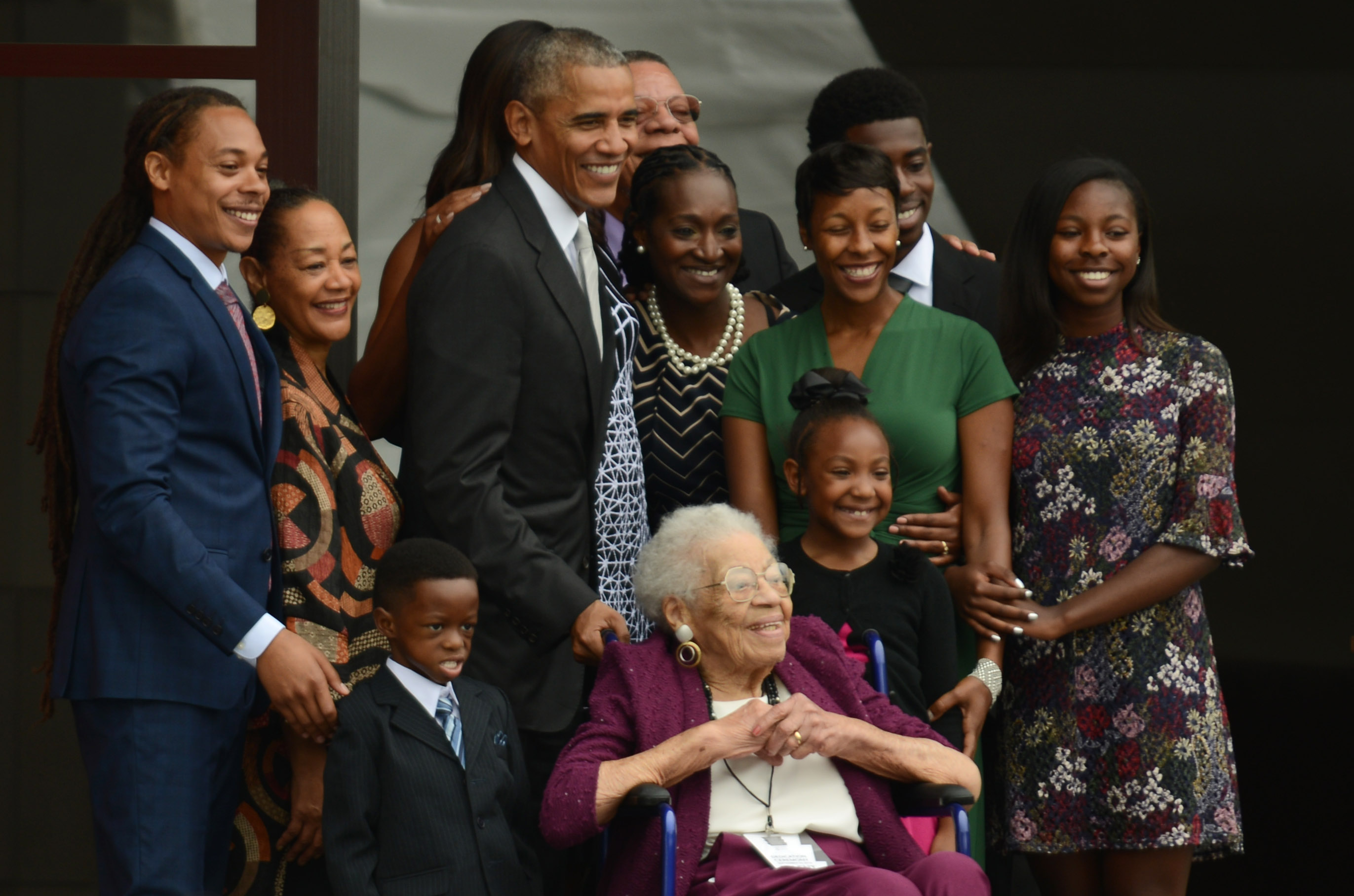 WASHINGTON, DC - SEPTEMBER 24: President Barack Obama and four generations of the Bonner family, who are descendants of slaves, stand together to have their picture taken after ringing the First Baptist Church Bell to officially open the Smithsonian's National Museum of African American History and Culture in Washington, DC, USA, 24 September 2016.