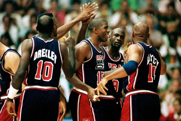 Members of the United States Men's National Basketball Team celebrate on the court during the 1992 Summer Olympics in Barcelona, Spain.