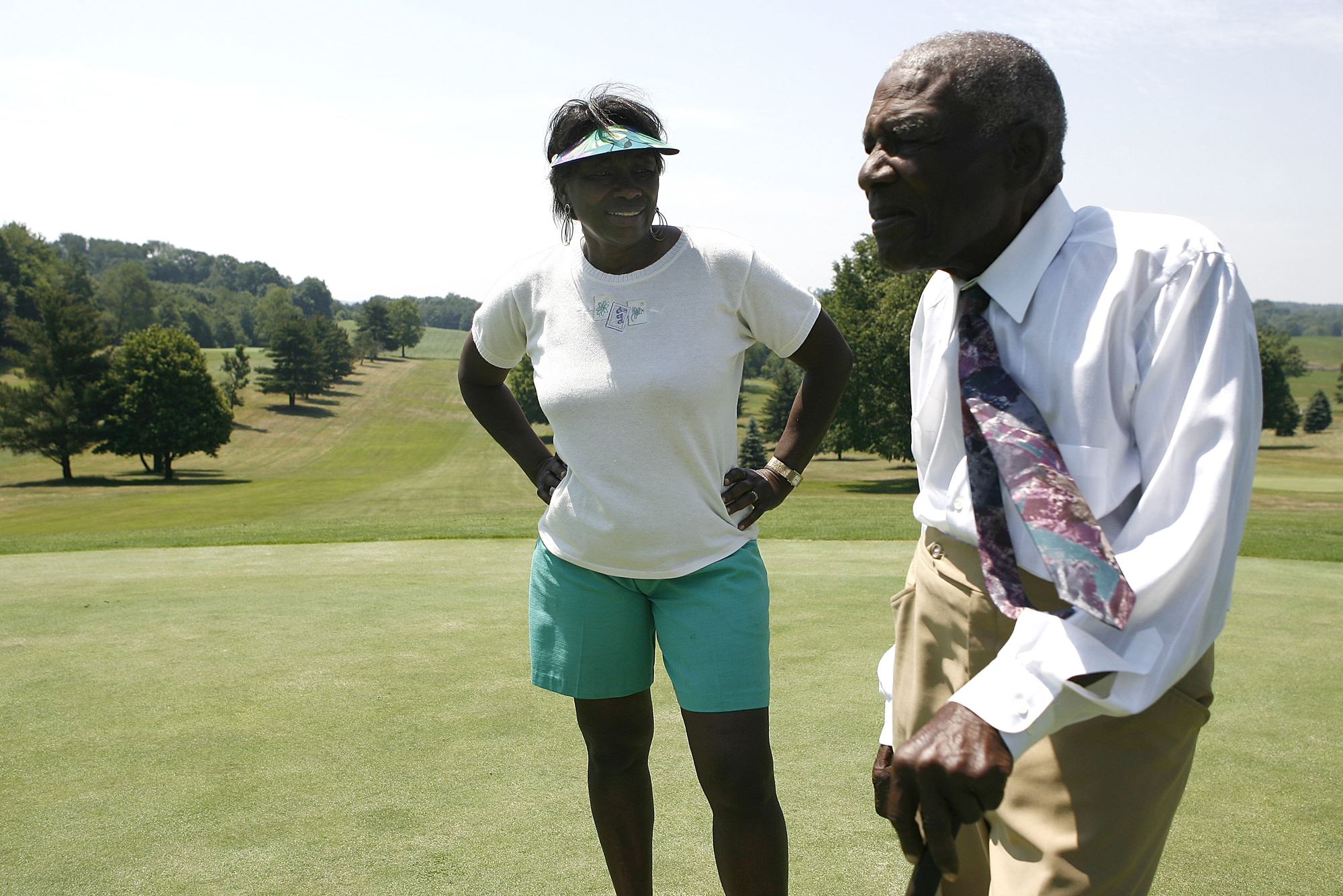Bill Powell and his daughter Renee Powell talk on a green at Clearview Golf Club on June 25, 2009 in East Canton, Ohio.