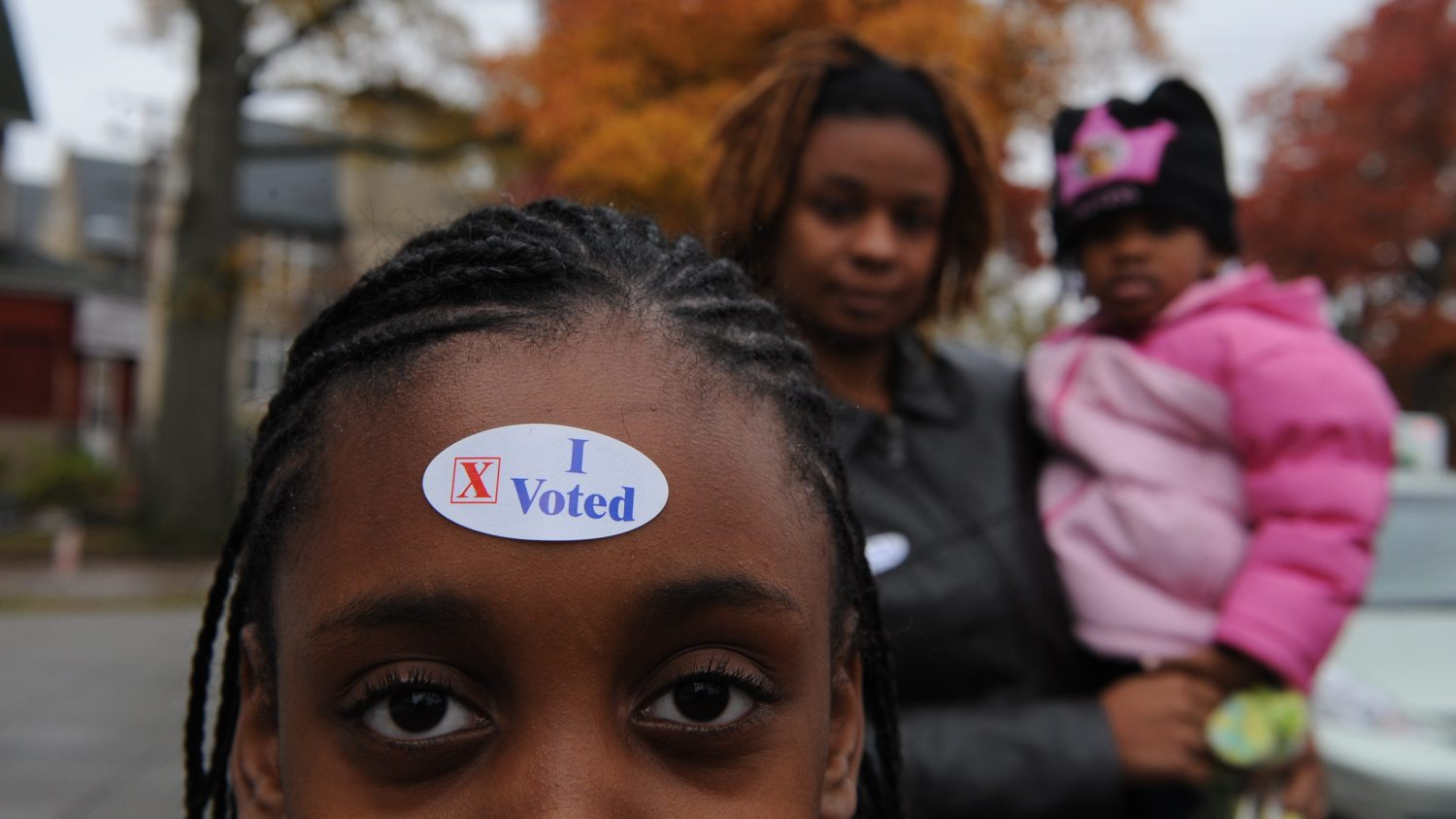 Kayla Wiley (10, of DC) sports a sticker on her head while h