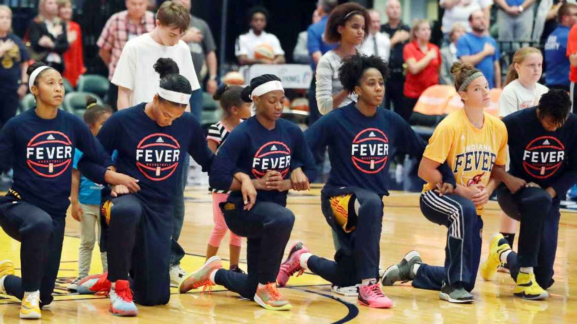 "In the team's pregame huddle after the anthem, Fever coach Stephanie White told her team, ""I'm proud of y'all for doing that together, being in that together. That's big. That's big. It's bigger than basketball, right? Bigger than basketball."""