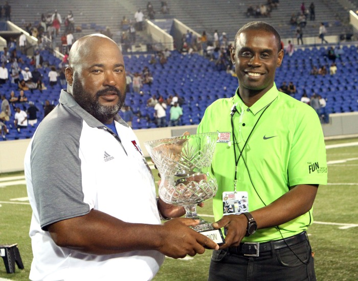 Nathaniel Jones, production manager of the Southern Heritage Classic presents Tennessee State Head Coach Rod Reed with the game winning trophy after defeating the Jackson State University Tigers 40-26 on Sept. 10 in Memphis, Tennessee at the Liberty Bowl Stadium.