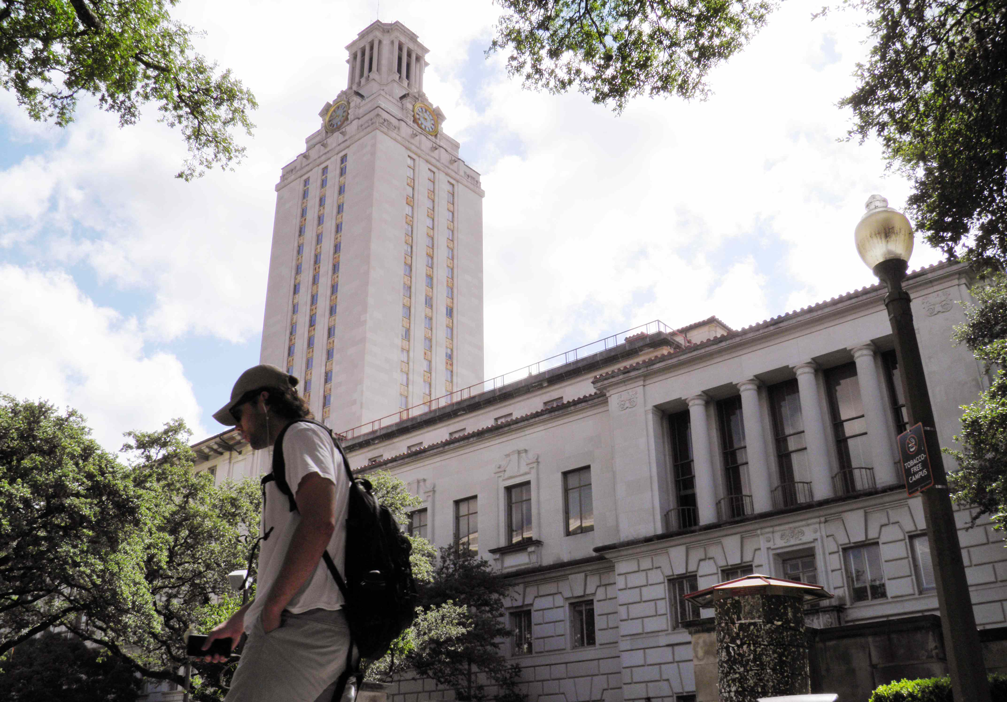 A student walks at the University of Texas campus in Austin, Texas, U.S. on June 23, 2016.