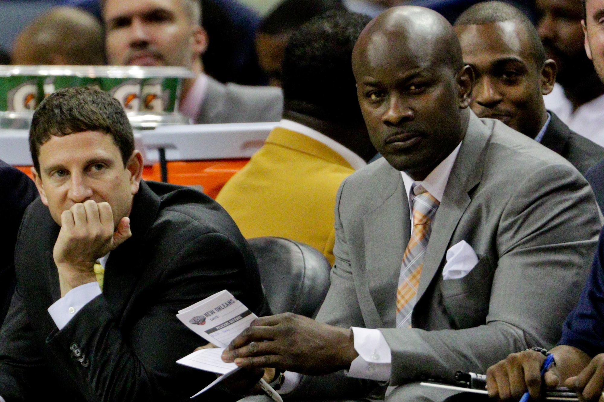 New Orleans Pelicans associate head coach Darren Erman (left) and assistant coach Robert Pack (right) during the first half of a game against the Miami Heat at the Smoothie King Center.