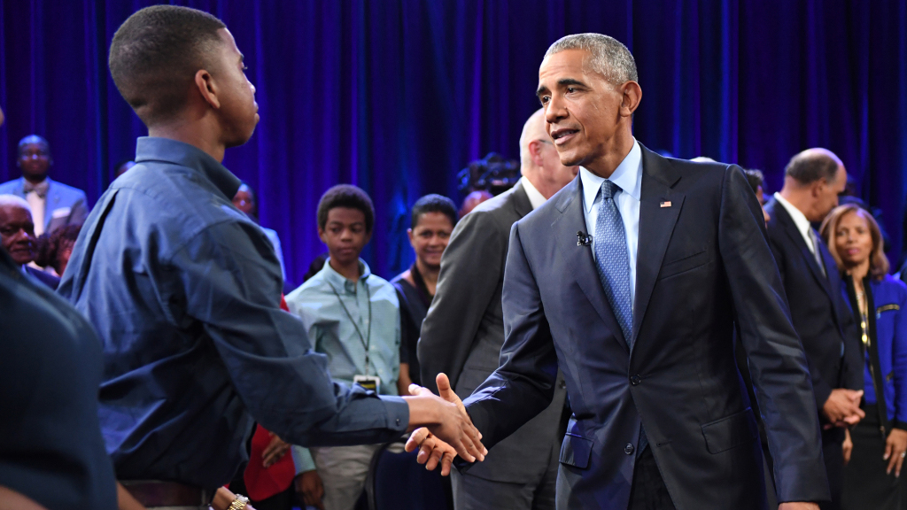 President Barack Obama shakes hands with audience member Jordan Greene after ESPN's The Undefeated: A Conversation with The President: Sports, Race and Achievement at the Alumni-Foundation Event Center on the campus of North Carolina A&T on October 11, 2016 in Greensboro, N.C.