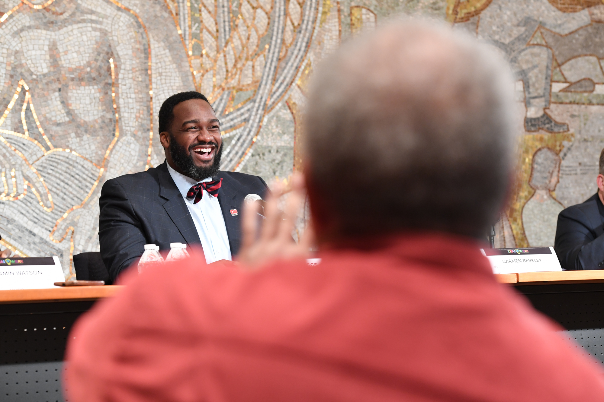 NFLPA Counsel Joe Briggs laughs while being asked question during the AFL-CIO's panel on the role of athletes and the labor movement when it comes to racial and social justice at the AFL-CIO on October 25, 2016 in Washington D.C. The panel, moderated by Dave Zirin, featured Director of Civil, Human and Women's Rights for the AFL-CIO Carmen Berkley, NFLPA Counsel Joe Briggs and NFLPA Vice President and Baltimore Ravens tight end Benjamin Watson discussed athletes roles in speaking out on social issues.