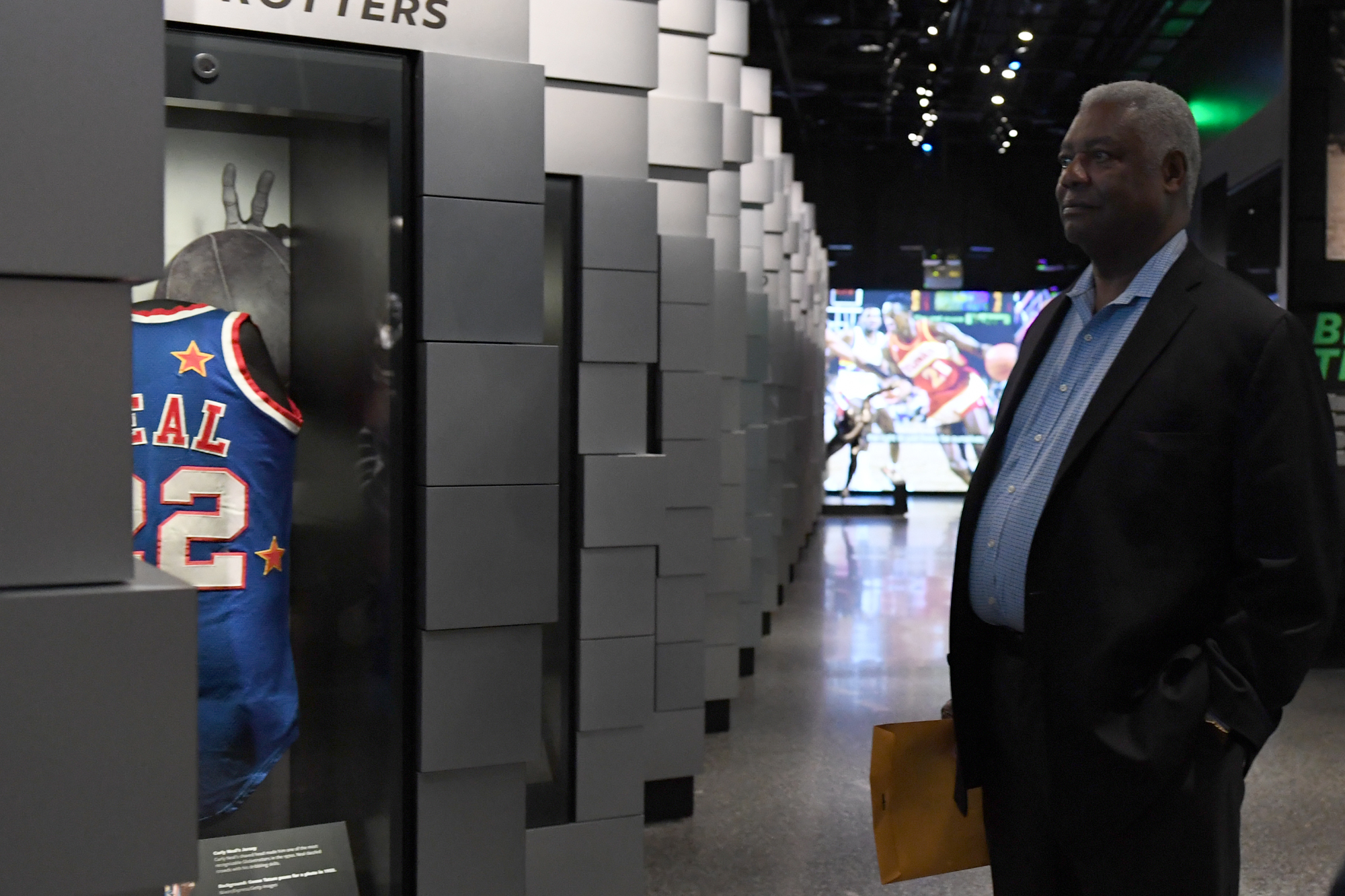 "Oscar Robertson watches a video on the Harlem Globetrotters after ""The Legend and The Prospect: A Conversation between Oscar Robertson and James ""J-Byrd"" Daniel III"" at the Oprah Winfrey Theater inside of The Smithsonian National Museum of African American History and Culture on October 28, 2016 in Washington D.C."