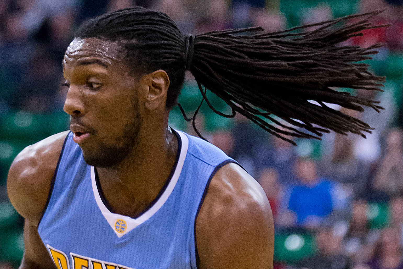 Denver Nuggets forward Kenneth Faried (35) drives toward the basket during the first half against the Utah Jazz at Vivint Smart Home Arena.