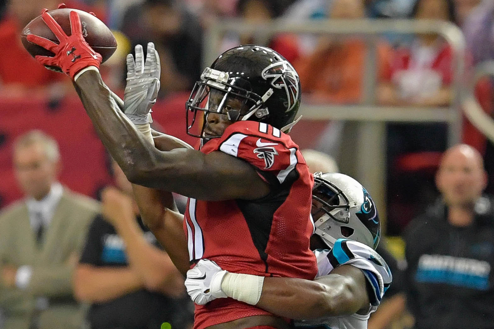 Atlanta Falcons wide receiver Julio Jones (11) makes a catch against Carolina Panthers cornerback Bene' Benwikere (25) during the second half at the Georgia Dome.