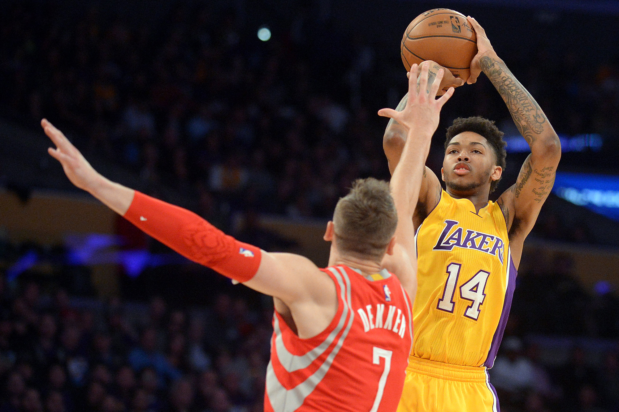 Los Angeles Lakers forward Brandon Ingram (14) shooots against the defense of Houston Rockets forward Sam Dekker (7) during the second half at Staples Center.