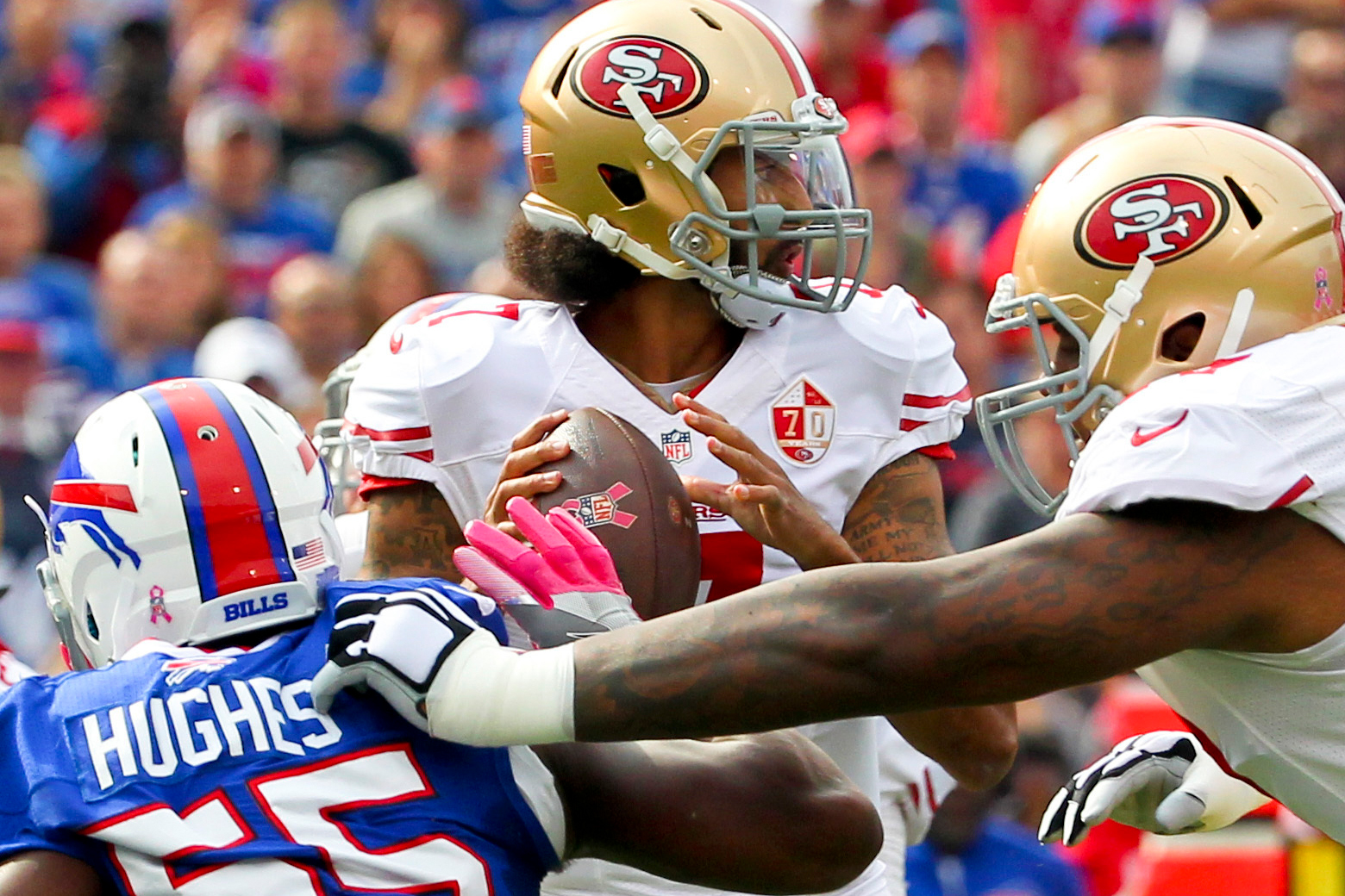 San Francisco 49ers quarterback Colin Kaepernick (7) passes under pressure from Buffalo Bills outside linebacker Jerry Hughes (55) during the first half of an NFL football game on Sunday, Oct. 16, 2016, in Orchard Park, N.Y.