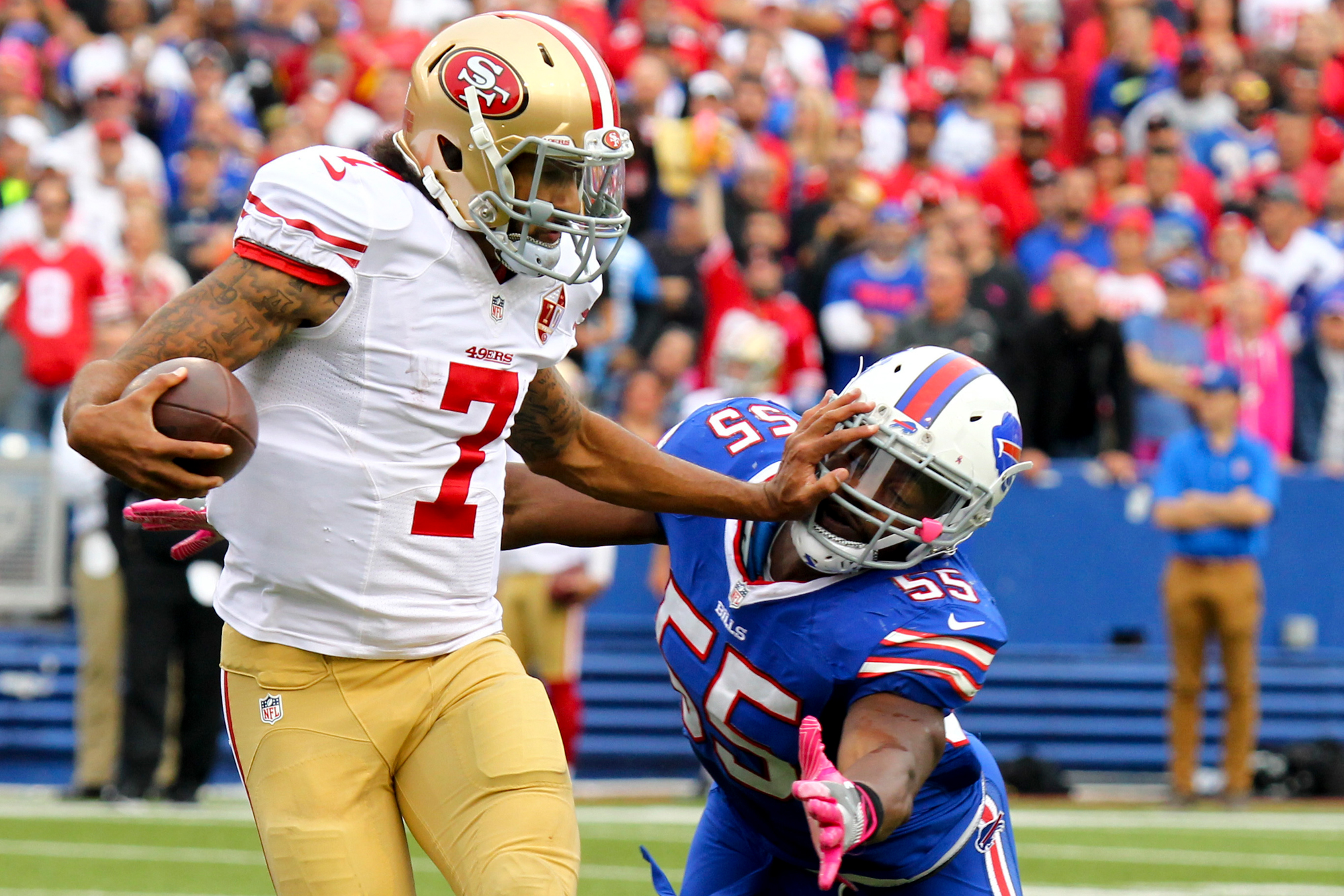 San Francisco 49ers quarterback Colin Kaepernick (7) pushes off Buffalo Bills outside linebacker Jerry Hughes (55) during the second half of an NFL football game on Sunday, Oct. 16, 2016, in Orchard Park, N.Y.