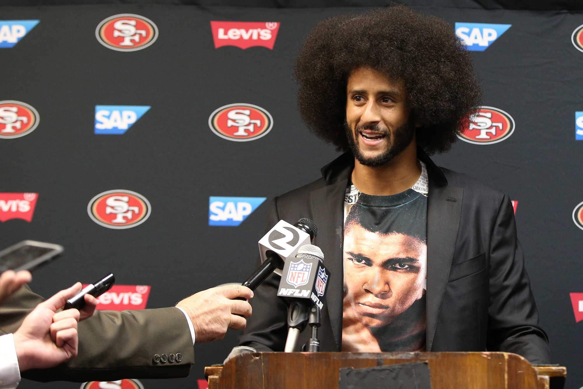San Francisco 49ers quarterback Colin Kaepernick (7) talks to reporters during a press conference after an NFL game between the San Francisco 49ers and Buffalo Bills at New Era Field in Orchard Park, NY.