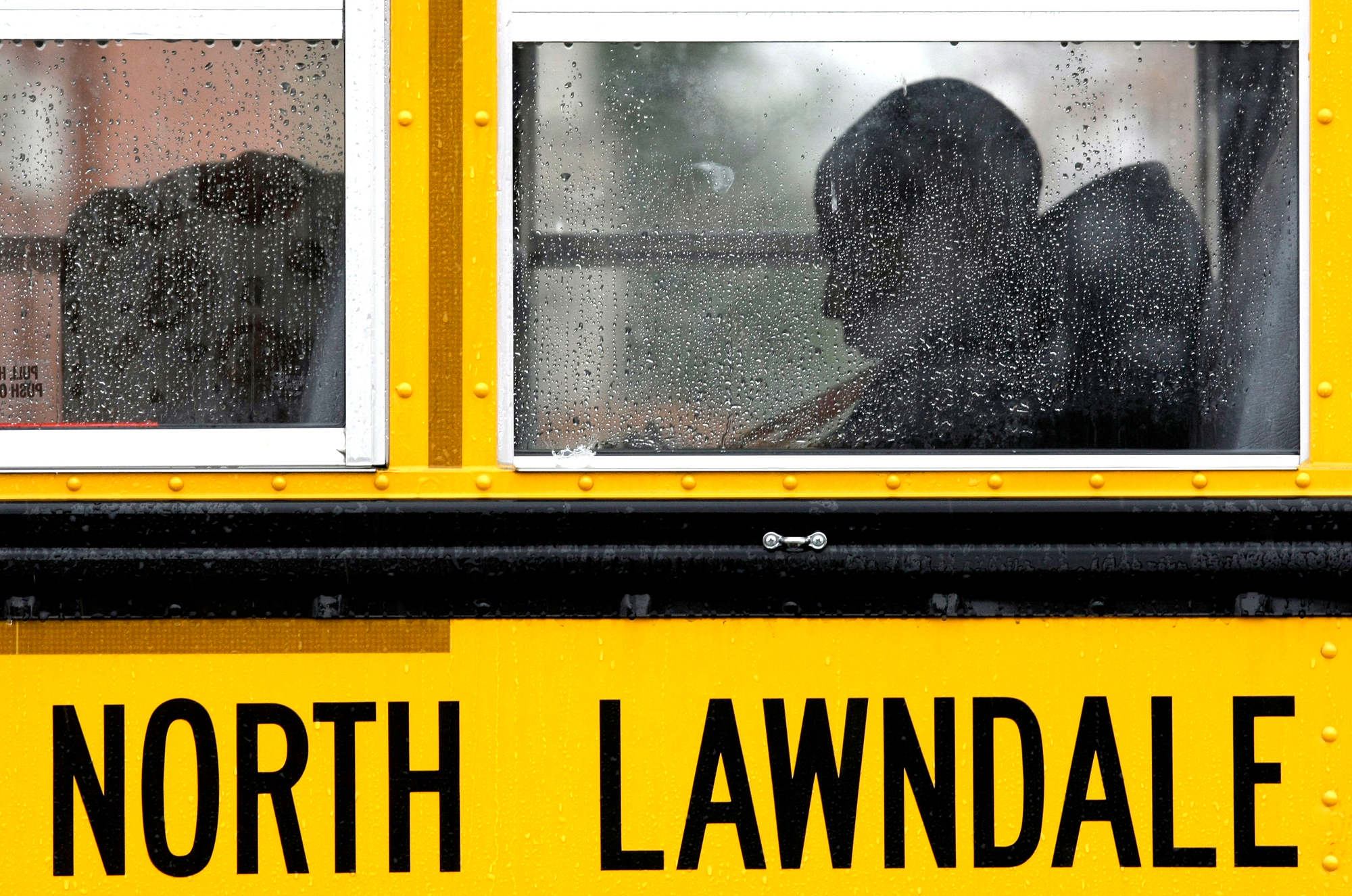 An unidentified student from the North Lawndale College Prep High School sits on a bus for the trip home on Chicago's Westside, Friday, Nov. 14, 2008.