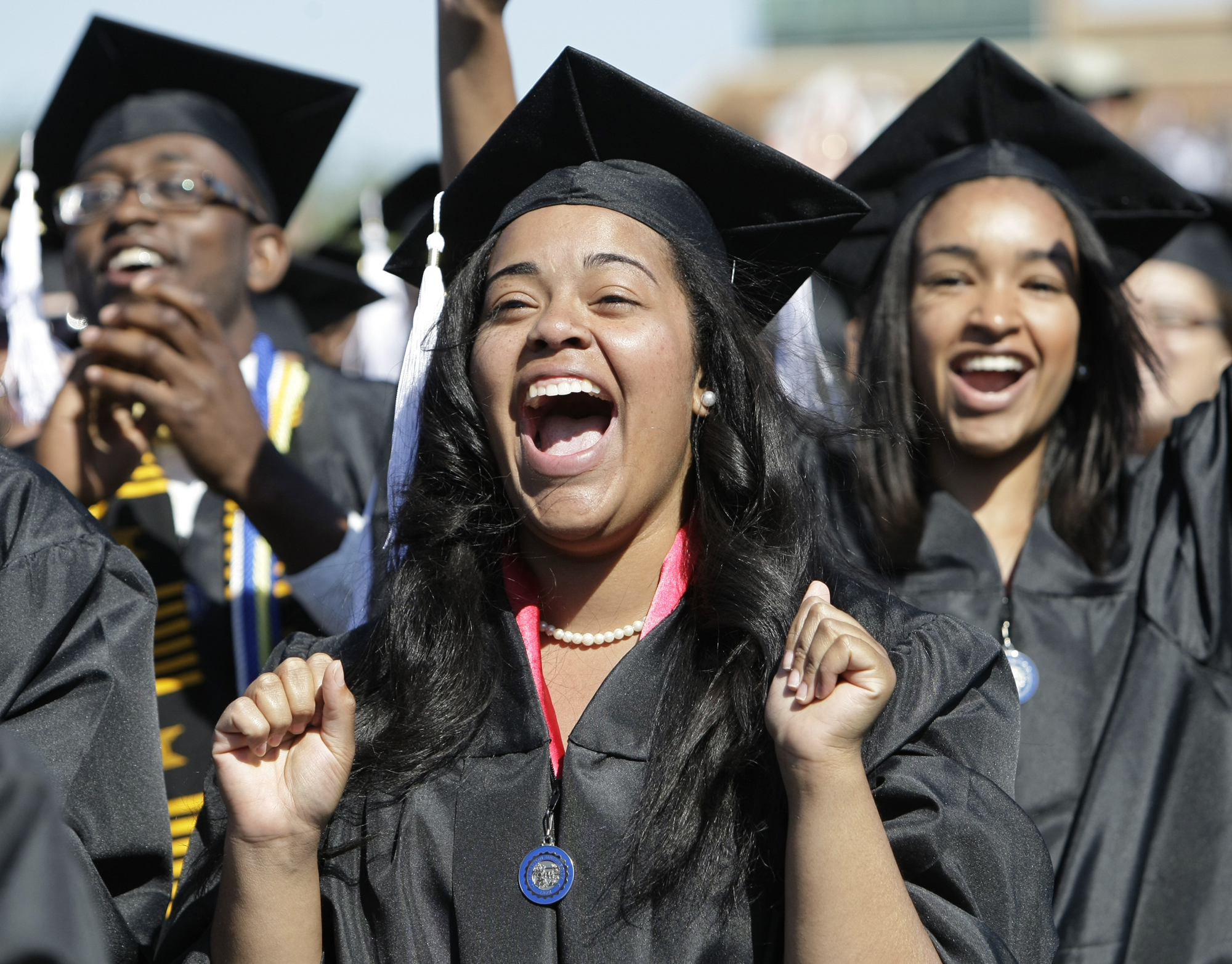 Tara Haskins of Virginia Beach, Va., shouts as President Barack Obama arrives at graduation ceremonies at Hampton University, a historically black university, at the school's Armstrong Stadium, in Hampton, Va., Sunday, May 9, 2010.