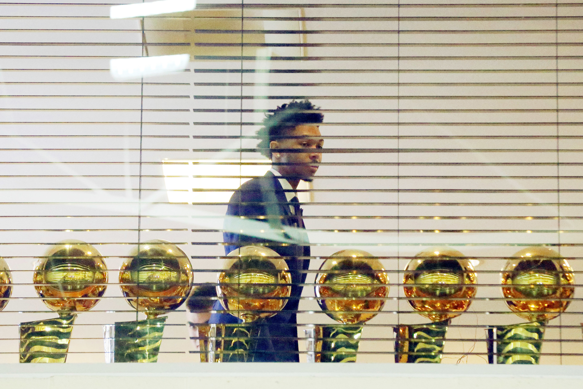 The Los Angeles Lakers' No. 2 draft pick Brandon Ingram looks at Lakers championship trophies in a room overlooking the basketball court before he is introduced at the NBA team's headquarters in El Segundo, Calif., Tuesday, July 5, 2016.