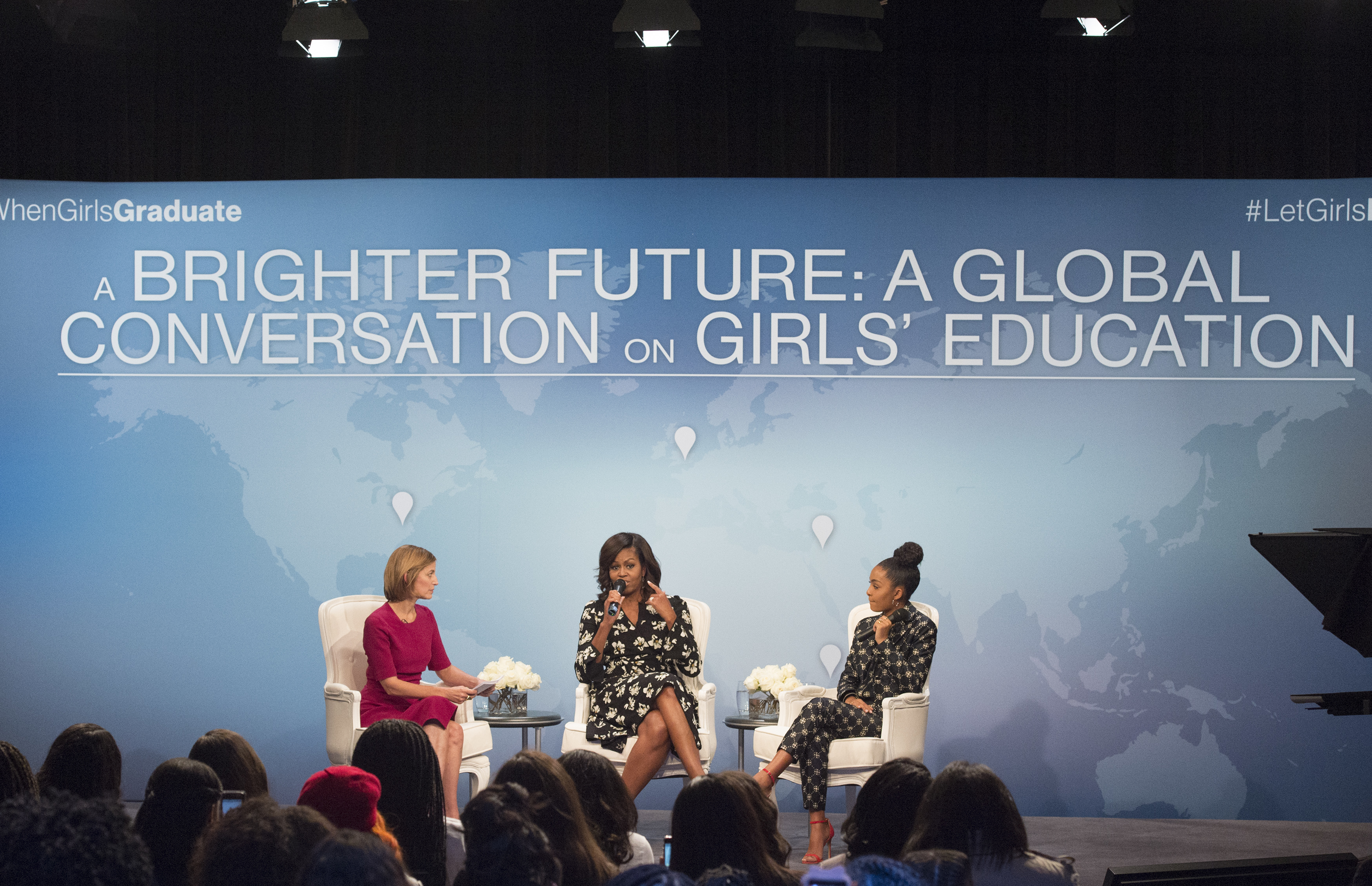 "First lady Michelle Obama, accompanied by actress Yara Shahidi, right and Glamour magazine Editor in Chief Cindi Leive, participates in Glamour's ""A Brighter Future: A Global Conversation on Girls' Education,"" in celebration of International Day of the Girl and Let Girls Learn, Tuesday, Oct. 11, 2016, at the Newseum in Washington."