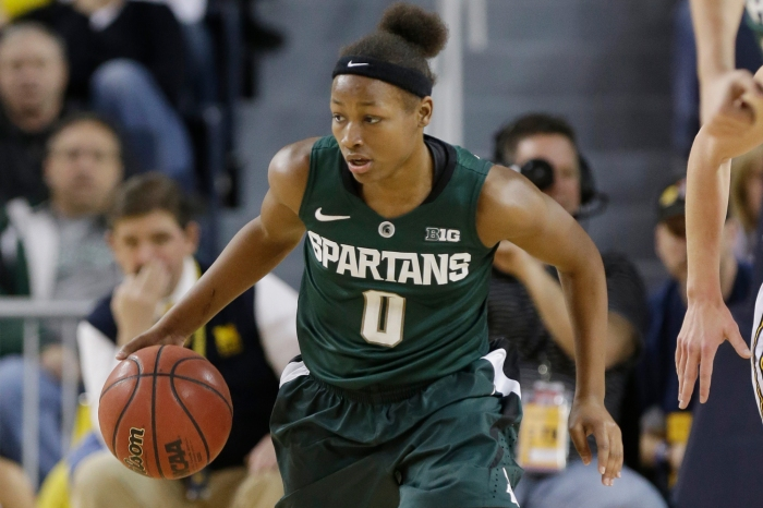 Michigan State guard Kiana Johnson (0) brings the ball downcourt during the second half of an NCAA college basketball game against Michigan at Crisler Center in Ann Arbor, Mich., Saturday, Feb. 16, 2013.