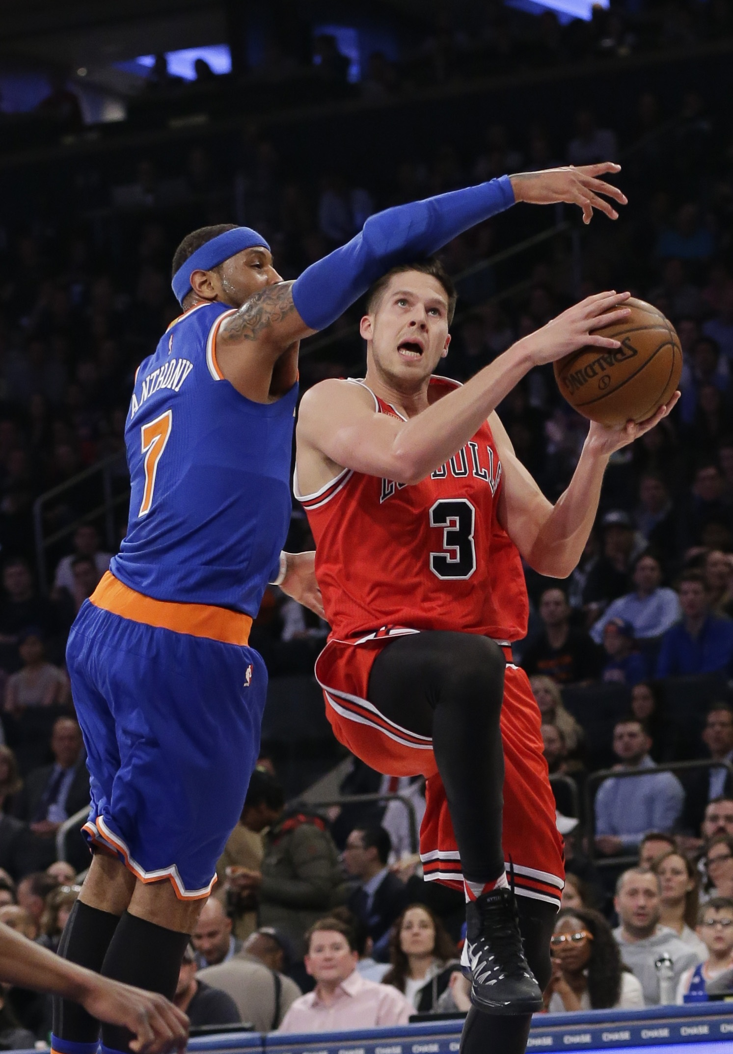 7ea3fca21 Chicago Bulls  Doug McDermott (No. 3) drives past New York Knicks  Carmelo  Anthony (No. 7) during the first half of an NBA basketball game March 24 in  New ...