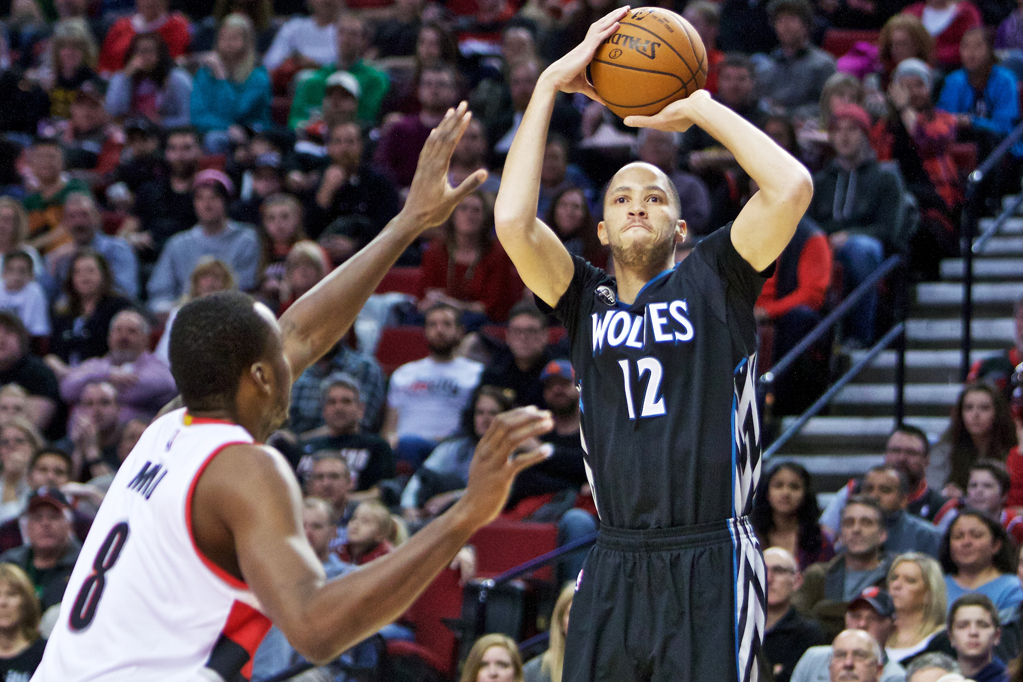 Minnesota Timberwolves forward Tayshaun Prince, right, shoots over Portland Trail Blazers forward Al-Farouq Aminu, left, during the first half of an NBA basketball game in Portland, Ore., Sunday, Jan. 31, 2016.