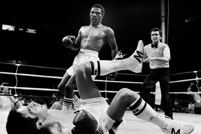 World Boxing Association junior welterweight champ Aaron Pryor stands over challenger Akio Kameda as referee Ernesto Magana moves in during the second round of a title fight in Cincinnati, July 4, 1982. The fight ended in the sixth round on a TKO with Pryor retaining the title.