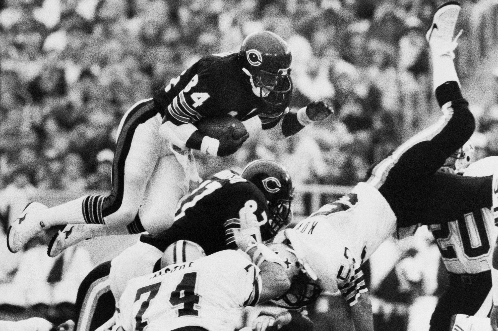 Chicago Bears' Walter Payton (34) is up and over for short yardage during second quarter action against the New Orleans Saints, Oct. 7, 1984, Chicago, Ill.