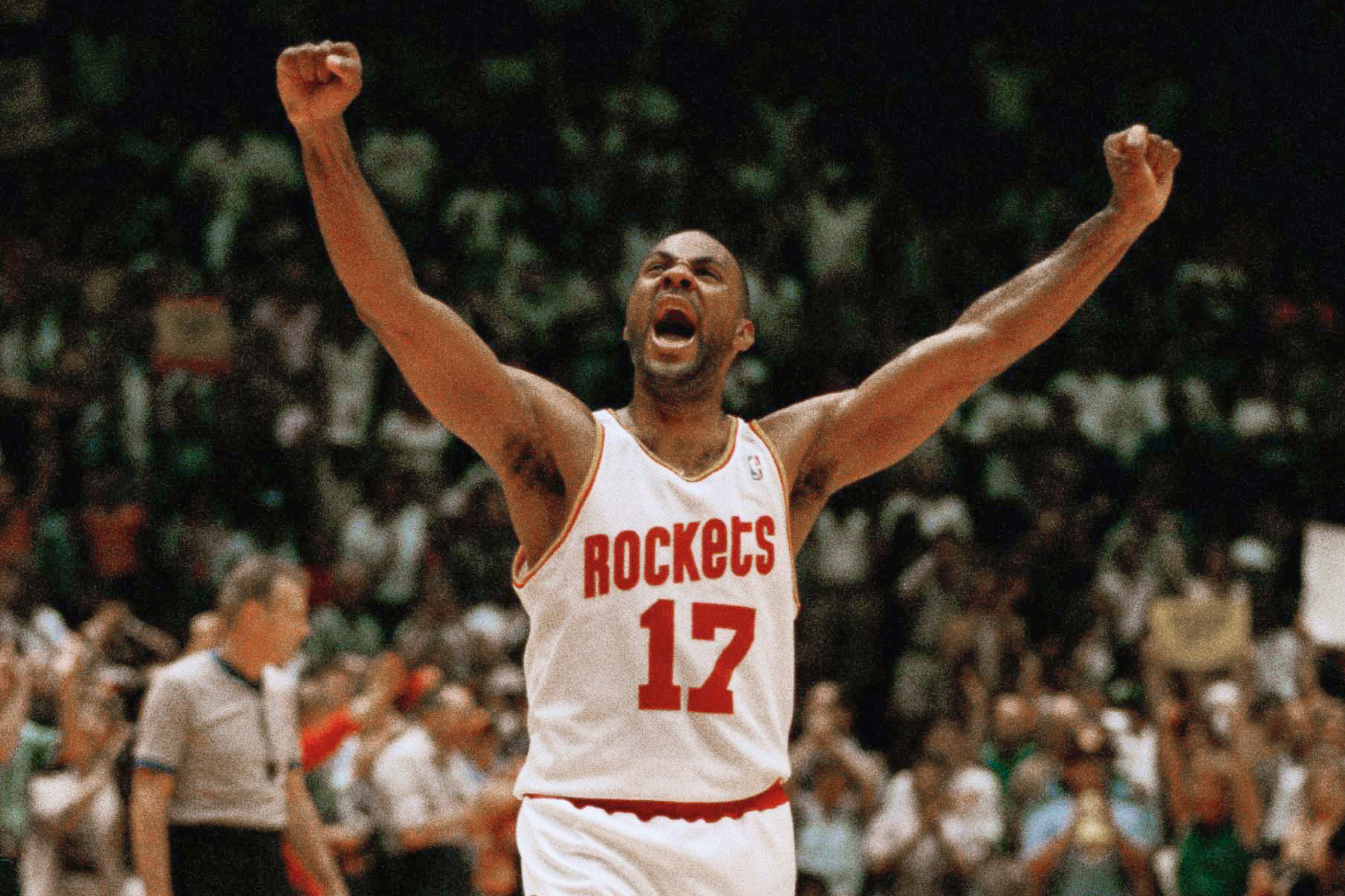Houston Rockets Mario Elie celebrates during the closing minutes of their NBA Western Conference semifinal game against the Phoenix Suns, Saturday, May 21, 1994, Houston, Tex.