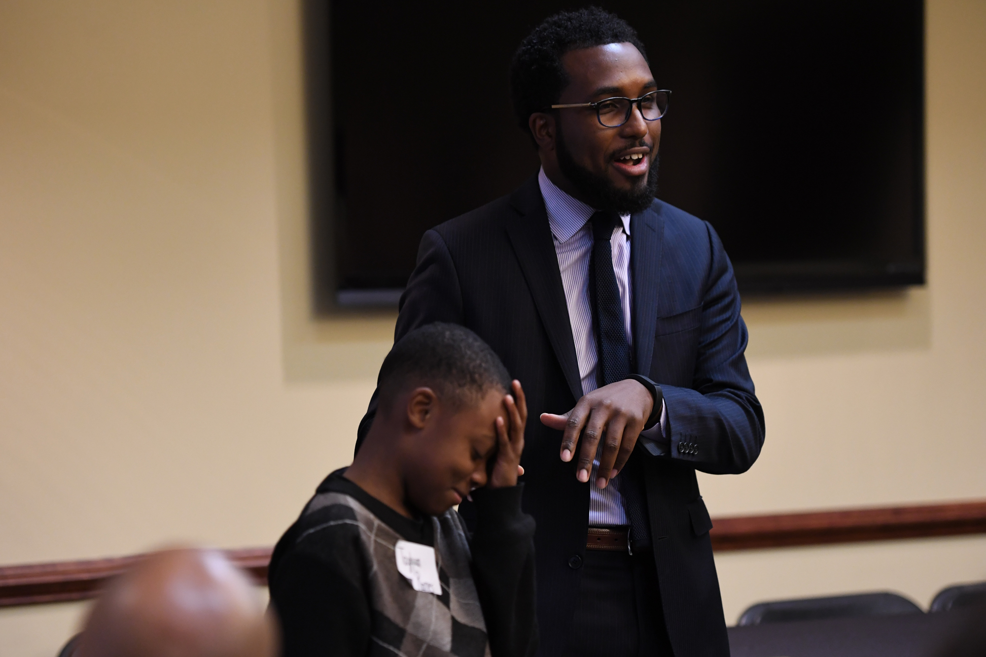Niiobli Armah IV puts Tayquan Barnes on the spot about his knowledge of all the presidents during the Summit for My BrotherÕs Keeper at the United Way of Greater Greensboro on October 10, 2016 in Greensboro, North Carolina.