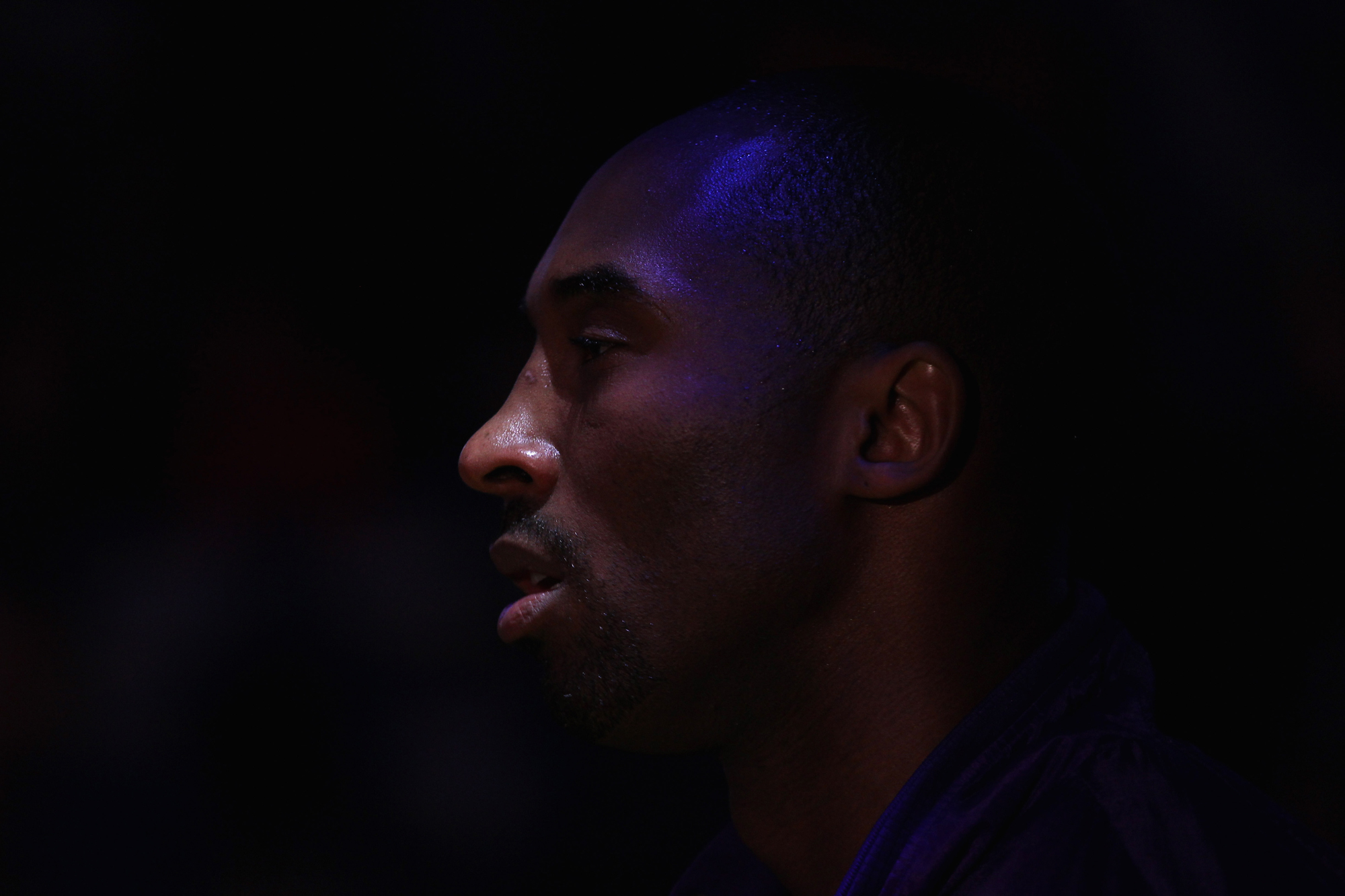 Kobe Bryant #24 of the Los Angeles Lakers stands on the side of the court while the Golden State Warriors are introduced before their game at Oracle Arena on March 27, 2012 in Oakland, California.