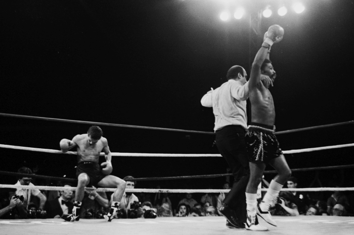 Aaron Pryor (R) celebrates after knocking down Alexis Arguello during the bout at the Orange Bowl on November 12, 1982 in Miami, Florida. Aaron Pryor won the WBA World light welterweight title.