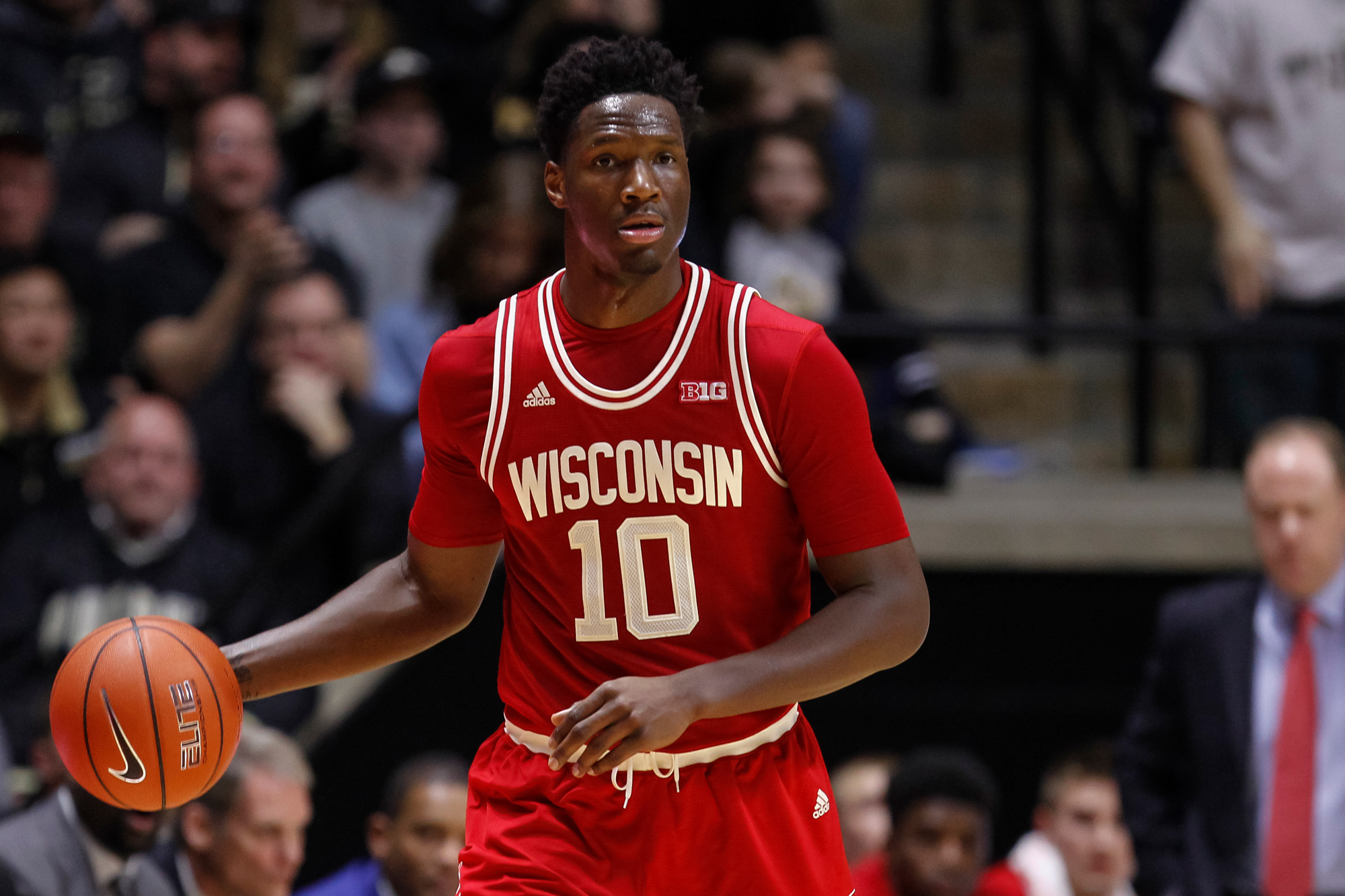 Nigel Hayes #10 of the Wisconsin Badgers brings the ball up court during the game against the Purdue Boilermakers at Mackey Arena on March 6, 2016 in West Lafayette, Indiana.
