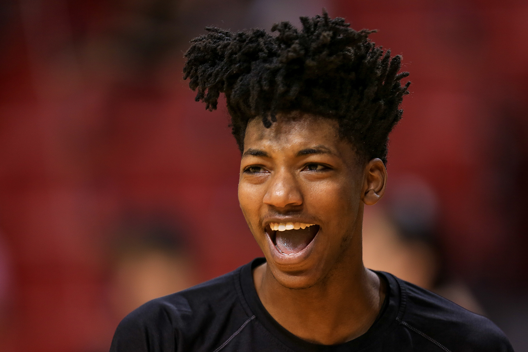 Elfrid Payton #4 of the Orlando Magic looks on before the game against the Miami Heat at the American Airlines Arena on April 10, 2016 in Miami, Florida.