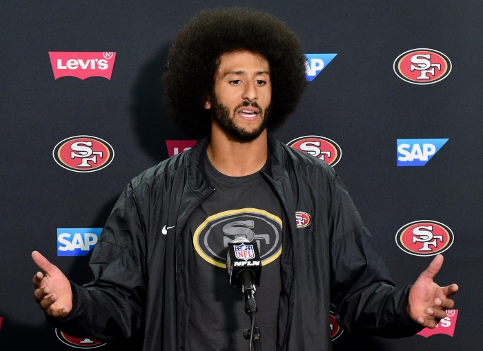 SAN DIEGO, CA - SEPTEMBER 01: Colin Kaepernick #7 of the San Francisco 49ers speaks to media during a press conference after a 31-21 preseason win over the San Diego Chargers at Qualcomm Stadium on September 1, 2016 in San Diego, California. (Photo by Harry How/Getty Images)